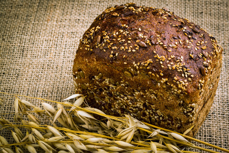 fresh white bread and oats isolated on white background