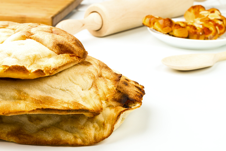 fresh pita bread isolated on white background photo