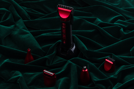 hair clipper on green background Stock Photo