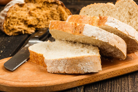 fresh white bread on wooden background photo