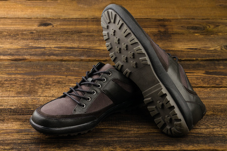 combined  mans shoes on wooden background