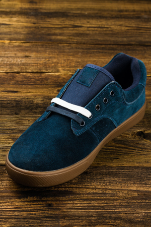 rubber lining: dark blue mans shoe on wooden background Stock Photo