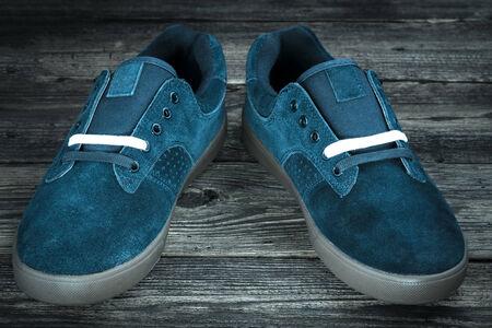 dark blue mans shoe on wooden background Stock Photo