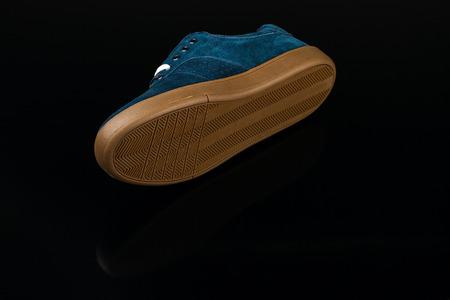 rubber lining: dark blue velvet mans shoe on black background