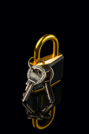 hinged: hinged lock with keys on black background Stock Photo