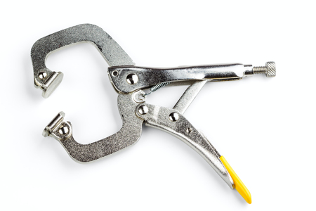 swivel: Locking C-clamp with swivel pads isolated on white