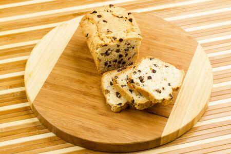 fruitcake: Chocolate fruitcake on chopping board Stock Photo