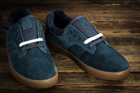 rubber lining: Dark blue mans shoe on wooden