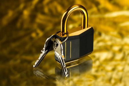 llaves: cerradura con bisagras con llaves en el fondo de oro Foto de archivo