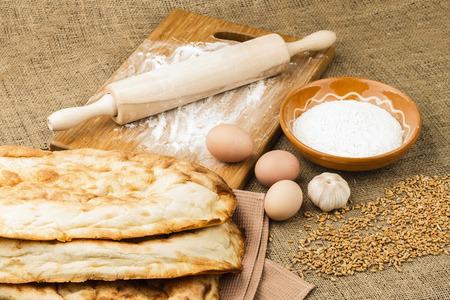 sacking: fresh pita bread on sacking background