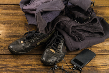 sportswear,  smartphone and accessories  on wooden background Stock Photo