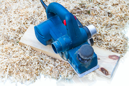 planer: power planer on sawdust background