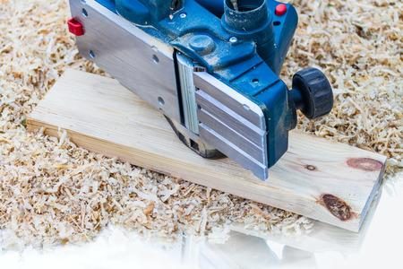 planer: power planer on sawdust background