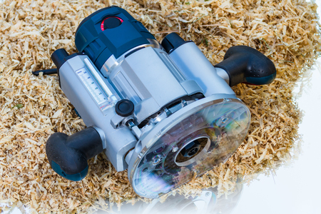 variable: variable speed plunge router on sawdust background