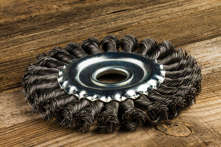 new metal brush on wooden background Stock Photo