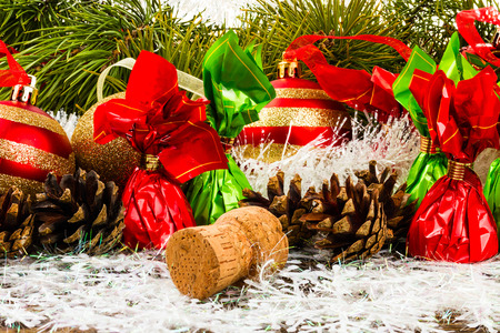 New Year Christmas-tree background with pine cone, christmas ball, champagne corks and candies