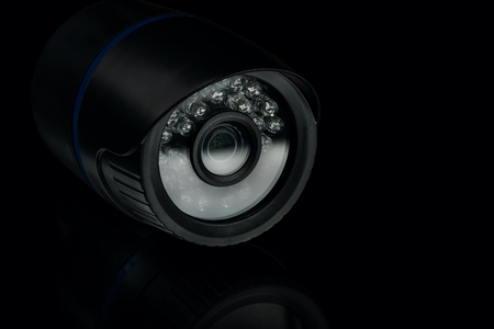 infrared motion sensor nightvision security camera on black background, low-key