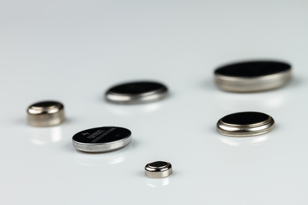 set of lithium button cell batteries on white background