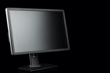 Digital black computer monitor screen on black background