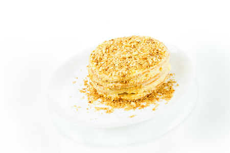 puff homemade cake with custard and biscuit crumb on white background