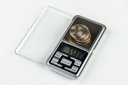 digital jewellery scales with coins on white background