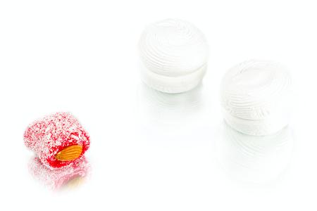 soft sweet marshmallows with  apricot jam inside and rakhat-lukum on white background, turkish sweets