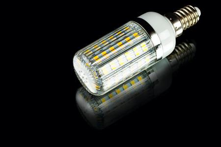 white innovation energy-saving corn LED bulb on black background