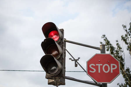 Traffic lights at outdoors. At a traffic light the three colors, with red stop sign