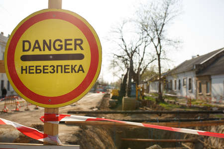warning signs about danger on the road, repair work in Ukraine
