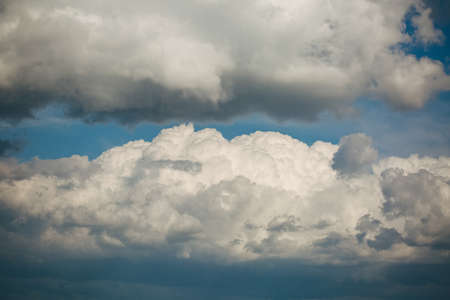 blue sky and fluffy white clouds, a cloudy day in Ukraine, photo tinted colors