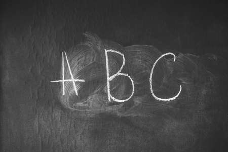 chalk written ABC on the blackboard, a school board in the lesson of primary classes