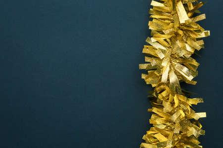 gold stripe decoration on a blue background, garland yellow Standard-Bild