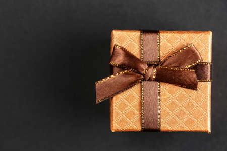 Gift boxes on a black background, holiday packages for wedding rings, top view Stock Photo