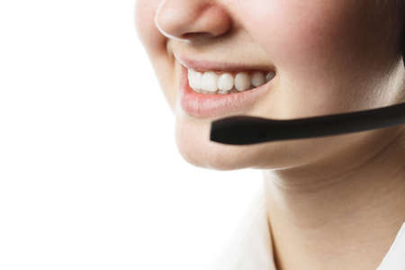 call center worker close-up on an isolated white background, young girl with headphones and microphone, online technical assistance