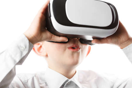 child in virtual reality mask is isolated on white background, boy in shirt plays. vr 360 vision goggles enjoying video game isolated on clear background in innovation and gaming technology concept.