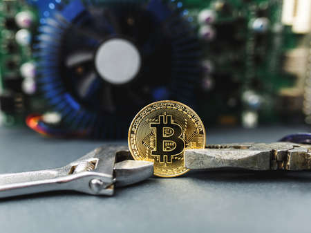 bitcoin on the video card, bitcoin coin on the table near the computer board, a lot of free space