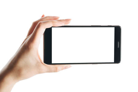 woman hand holds smartphone isolated on white background, with a clean screen Zdjęcie Seryjne