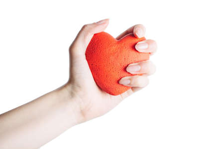 female hand with red heart on palm, isolated on white background. concept of a healthy lifestyle and love