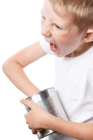 child eats from a tin can, starving boy looking to eat, photo isolated on a white background