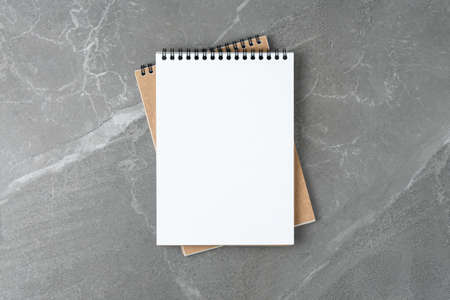 School notebook on the marble table top view. business concept