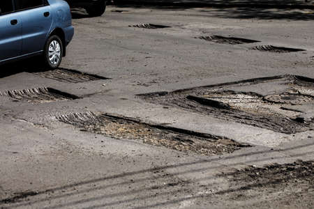 repair works are being carried out, road repairs in Ukraine, a big hole on the road asphalt result of military operations Stock fotó