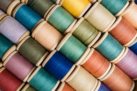 rolls of colorful threads, close-up and top view. home set for clothes repair, colorful thread
