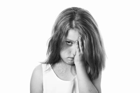 little girl with tears in her eyes isolated on white background, the child is crying, the concept of protecting children, the schoolgirl is crying. black and white. Stock Photo