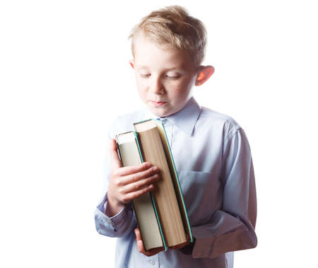 little happy boy with books in hands, portrait on isolated white background, schoolboy with book in hands Stock Photo