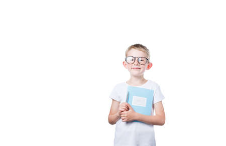 schoolboy holding a notebook in hands isolated on a white background, a boy wearing glasses, a child is getting ready to go to school