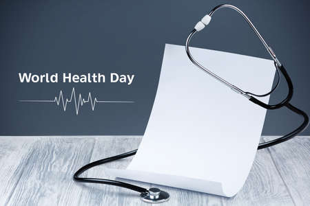 world health day. empty sheet on the table with a stethoscope, doctors day, doctors desk, medical concept for the day of fighting diseases