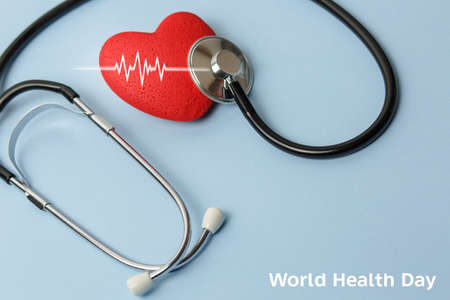 world health day. Health day stethoscope on a blue background with a red heart, free space, concept medicine and a doctors office, a table of the doctor heart disease, diagnosis love.