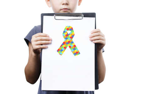 little girl holding tablet with puzzle ribbon. World Autism Awareness day. symbol combating cancer and AIDS, isolated on white background. Day against HIV and Cancer