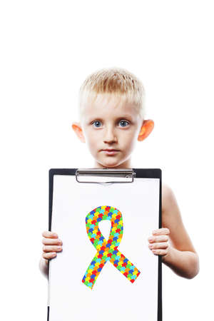 little boy holding tablet with puzzle ribbon. World Autism Awareness day. symbol combating cancer and AIDS, isolated on white background. Day against HIV and Cancer