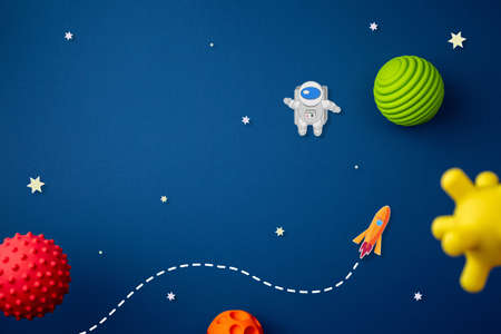 planet, astronaut, stars and rocket on deep blue background imitation of space. Cosmonautics Day concept. April 12th day of the first human space flight. space shuttle flat lay Stock Photo
